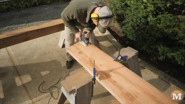 A powerful jigsaw with a heavy blade works well at cutting the rafters