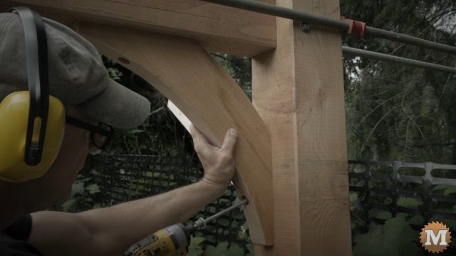 A similar brace being installed on my woodshed
