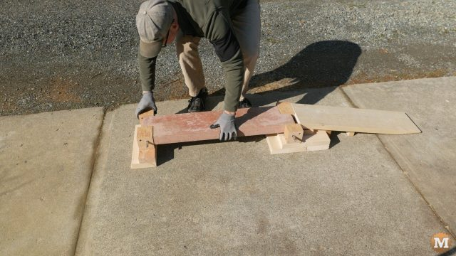 Loading a concrete panel into the simple testing rig