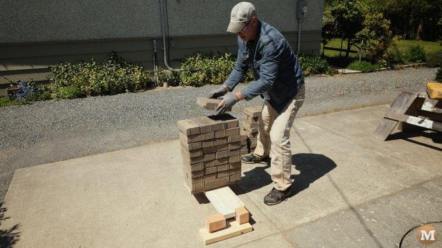 loading the concrete panel with a stack of bricks