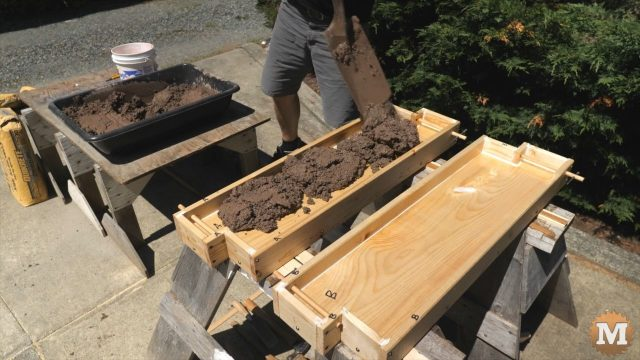 DIY Concrete Garden Bed Easy Form - Shovel wet concrete into form