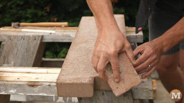 DIY Concrete Garden Box Easy Form - Remove sharp edge of casting with brick