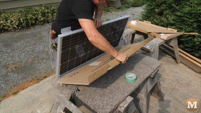 taping cardboard to protect and shield the solar panel